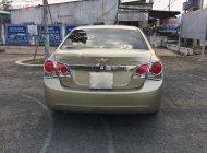 Cần bán Chevrolet Cruze đời 2014, màu vàng, giá tốt giá 330 triệu tại Long An