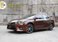 Cần bán Toyota Corolla Altis 1.8G đời 2015, màu nâu, giá chỉ 520 triệu giá 520 triệu tại Hà Nội