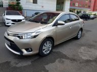 Bán Toyota Vios E MT sản xuất 2015, màu vàng số sàn, giá 385tr giá 385 triệu tại Tp.HCM