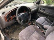 Cần bán gấp Kia Spectra năm 2004, màu bạc xe gia đình, 95tr giá 95 triệu tại Hà Tĩnh