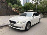 BMW 523i sản xuất năm 2011 màu trắng nội thất đen giá 810 triệu tại Hà Nội