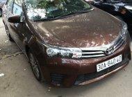Cần bán xe Toyota Corolla Altis 1.8G MT đời 2015, màu nâu, giá tốt giá 500 triệu tại Hà Nội