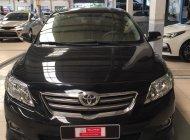 Cần bán Toyota Corolla altis 1.8G đời 2009, màu đen giá 470 triệu tại Tp.HCM