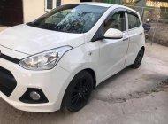 Cần bán gấp Hyundai Grand i10 sản xuất 2014, màu trắng số sàn, giá 230tr giá 230 triệu tại Thanh Hóa