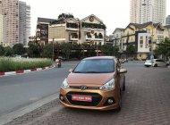 Cần bán lại xe Hyundai Grand i10 AT đời 2015, màu nâu, số tự động, 325tr giá 325 triệu tại Hà Nội