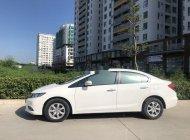 Cần bán Honda Civic AT năm sản xuất 2015, màu trắng , nội thất kem giá 680 triệu tại Tp.HCM