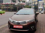 Bán xe Toyota Corolla altis 1.8 đời 2015, màu nâu, số tự động, 595tr giá 595 triệu tại Hà Nội