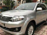 Bán Toyota Fortuner sản xuất năm 2013, màu bạc giá 595 triệu tại Tp.HCM