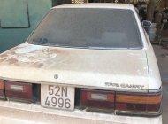 Cần bán gấp Toyota Camry năm sản xuất 2000, màu trắng, nhập khẩu nguyên chiếc, giá 48tr giá 48 triệu tại Bình Phước