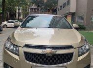 Cần bán gấp Chevrolet Cruze MT đời 2012, màu vàng, nhập khẩu xe gia đình giá 275 triệu tại Hà Nội
