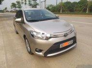 Cần bán xe Toyota Vios đời 2014, màu vàng cát, giá tốt giá 310 triệu tại Hà Nội