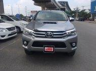Cần bán xe Toyota Hilux G sản xuất 2015, màu bạc, giá thương lượng giá 690 triệu tại Tp.HCM