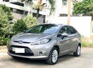 Mình cần bán Ford Fiesta AT, màu xám, model 2013 giá 299 triệu tại Tp.HCM