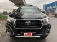 Cần bán lại xe Toyota Hilux đời 2019, màu đen giá 850 triệu tại Tp.HCM