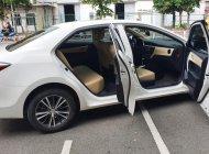 Cần bán lại xe Toyota Corolla altis 1.8G đời 2018, màu trắng giá 740 triệu tại Tp.HCM