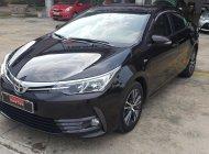 Cần bán lại xe Toyota Corolla Altis 2018, màu nâu giá 740 triệu tại Tp.HCM
