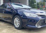 Cần bán gấp Toyota Camry 2.0E đời 2016, màu xanh lam giá cạnh tranh giá 710 triệu tại Tp.HCM