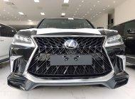 Lexus LX570 MBS 4 ghế VIP Model 2021 mới nhất màu đen nội thất da bò có trần sao mới giá 9 tỷ 900 tr tại Hà Nội