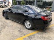 Cần bán Toyota Camry 2.0E đời 2013, màu đen giá thương lượng giá 670 triệu tại Tp.HCM