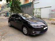 Nhà dư con Toyota Corolla altis 2018, số tự động, màu đen giá 598 triệu tại Tp.HCM