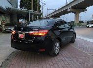 Cần bán gấp Toyota Corolla altis 1.8 MT năm 2014, màu đen giá Giá thỏa thuận tại Tp.HCM