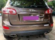 Nhà tôi cần bán Hyundai Santafe 2011, ĐK 2012 số tự động máy dầu, bản full, màu vàng giá 587 triệu tại Tp.HCM