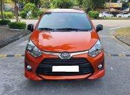 Mình cần bán Toyota Wigo 2019, số tự động, màu cam quyến rũ giá 358 triệu tại Tp.HCM