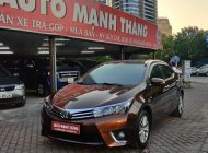 Cần bán xe Toyota Corolla altis 1.8G AT năm 2015, màu nâu giá 585 triệu tại Hà Nội