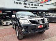 Cần bán xe Toyota Hilux E MT đời 2014, màu đen, nhập khẩu biển SG - giá cực tốt giá 450 triệu tại Tp.HCM
