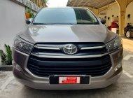 Cần bán lại xe Toyota Innova 2.0E 2018 màu đồng ánh kim giá 680 triệu tại Tp.HCM