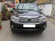Nhà cần bán Toyota Fortuner 2011, tự động, máy xăng, hai cầu, màu xám chì giá 439 triệu tại Tp.HCM