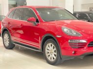Bán xe Porsche Cayenne sx 2013, màu đỏ giá 2 tỷ tại Tp.HCM