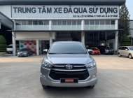 Cần bán lại xe Toyota Innova 2.0E đời 2019, màu bạc, biển SG mới chạy 58.000km - còn BH hãng giá 710 triệu tại Tp.HCM