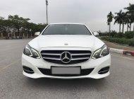 Mercedes E250 2015 màu trắng, nội thất nâu sang trọng. Chủ xe bảo dưỡng định kỳ thường xuyên giá 1 tỷ 30 tr tại Hà Nội