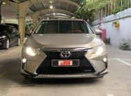 Cần bán Toyota Camry 2.0E đời 2015, màu nâu giá 770 triệu tại Tp.HCM