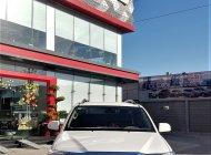 Cần bán Toyota Fortuner 2.7V đời 2014, màu trắng giá 710 triệu tại Tp.HCM