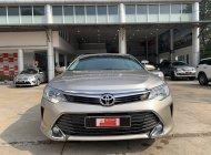Bán xe Toyota Camry 2.0E đời 2015, màu nâu giá 47 tỷ tại Tp.HCM