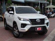 Cần bán gấp Toyota Fortuner 2.4G đời 2021, màu trắng giá 1 tỷ 160 tr tại Tp.HCM
