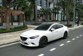 Cần bán lại xe Mazda 6 2.0 sản xuất năm 2015, màu trắng, giá tốt giá 735 triệu tại Tp.HCM
