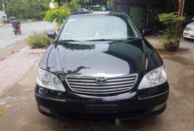 Cần bán lại xe Toyota Camry 2.4 G đời 2003, màu đen, giá chỉ 310 triệu giá 310 triệu tại Đồng Tháp