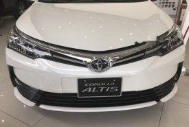 Bán Toyota Corolla altis sản xuất năm 2019, màu trắng, giao xe ngay giá 723 triệu tại Tp.HCM