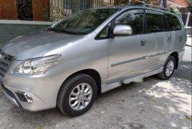Cần bán gấp Toyota Innova E đời 2014, màu bạc, số sàn giá cạnh tranh giá 492 triệu tại Tp.HCM