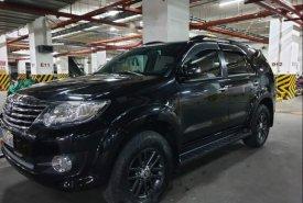 Bán Toyota Fortuner 2,7V AT đời 2016, màu đen  giá 850 triệu tại Tp.HCM
