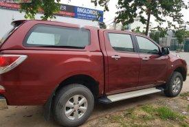 Cần bán xe Mazda BT 50 2.2L 4x4 MT đời 2015, màu đỏ, nhập khẩu nguyên chiếc số sàn giá 410 triệu tại Tp.HCM