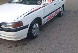 Cần bán Mazda 323 sản xuất 1997, màu trắng, nhập khẩu giá 34 triệu tại Thanh Hóa
