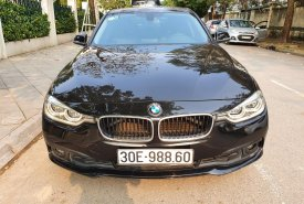 Bán gấp chiếc BMW 3 Series 320i, màu đen, nhập khẩu nguyên chiếc, giá rẻ giá 920 triệu tại Hà Nội
