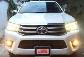 Cần bán lại xe Toyota Hilux đời 2016, màu trắng, nhập khẩu nguyên chiếc giá 730 triệu tại Tp.HCM